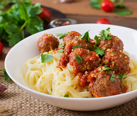 italian dish: Fettuccine Pasta with meatballs in tomato sauce
