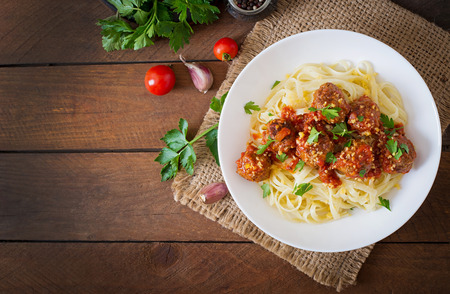 spaghetti dinner: Fettuccine Pasta with meatballs in tomato sauce. Top view Stock Photo