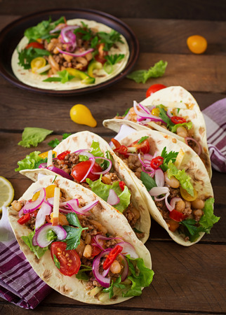 Mexican tacos with meat, beans and salsa.