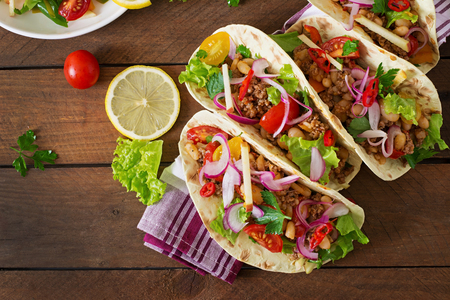 tacos: Mexican tacos with meat, beans and salsa. Top view