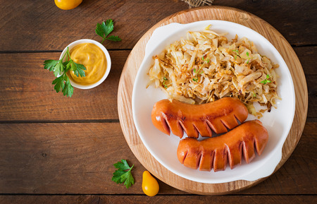 sausage: Sausages and fried cabbage. Top view Stock Photo