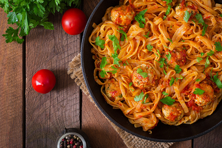 background wood: Pasta linguine with meatballs in tomato sauce. Top view Stock Photo