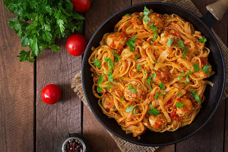 Pasta linguine with meatballs in tomato sauce. Top view Stock Photo