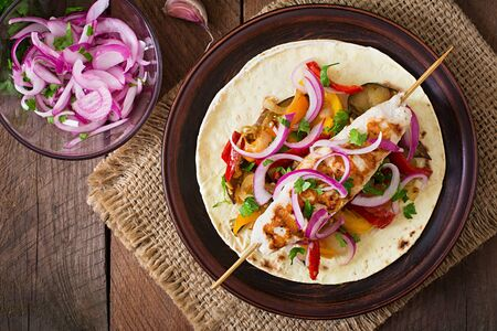 tortilla wrap: Chicken kebab with grilled vegetables and tortilla wrap. Top view Stock Photo