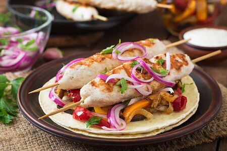 tortilla wrap: Chicken kebab with grilled vegetables and tortilla wrap. Stock Photo