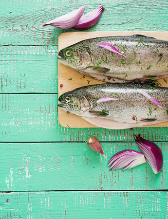 gutted: Gutted trout on a bright wooden background. Top view