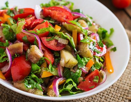 Salad baked eggplant and fresh tomatoes Stock Photo
