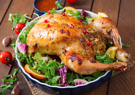chicken rice: Baked chicken stuffed with rice for Christmas dinner on a festive table Stock Photo