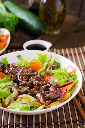 garlic: Salad with beef teriyaki Stock Photo
