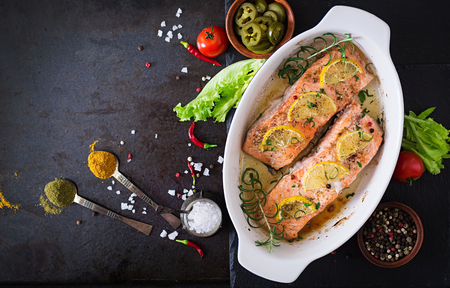 green fish: Baked salmon fillet with rosemary, lemon and honey. Top view