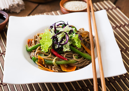 soba noodles: Soba noodles with beef, carrots, onions and sweet peppers. Stock Photo