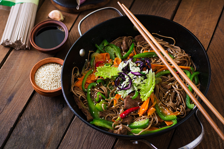 Soba noodles with beef, carrots, onions and sweet peppers. Stock Photo