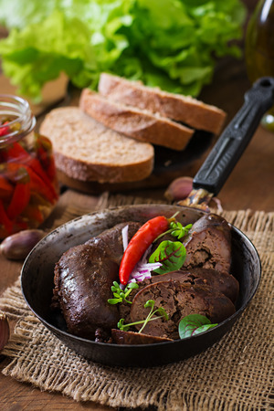offal: Homemade blood sausage with offal on the old wooden background in rustic style