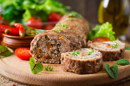 Minced meat loaf roll with mushrooms and carrots Stock Photo