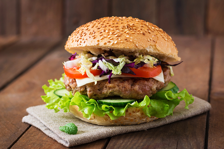 Sandwich hamburger with juicy burgers, cheese and mix of cabbage 스톡 콘텐츠