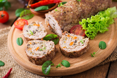 delicious food: Minced meat loaf roll with mushrooms and carrots Stock Photo