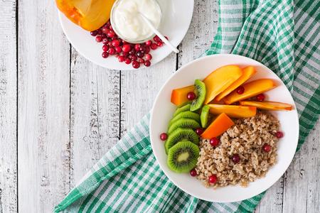 Porridge with fresh fruit and cranberries. Healthy breakfast. Proper nutrition. Dietary menu. Top view