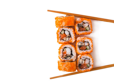 sushi restaurant: Traditional fresh japanese sushi rolls isolated on white background. Top view