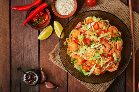 food and nutrition: Udon pasta with shrimp, tomatoes and paprika. Top view