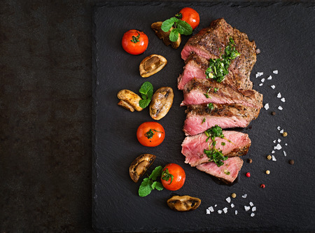 beef tenderloin: Juicy steak medium rare beef with spices and grilled vegetables. Top view