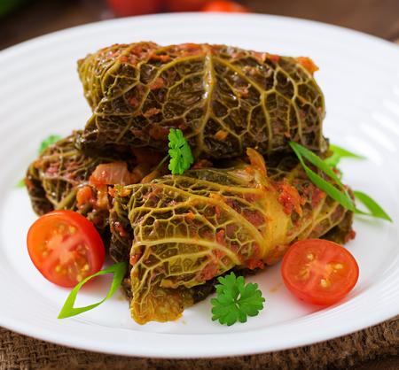savoy: Stuffed savoy cabbage rolls in tomato sauce Stock Photo