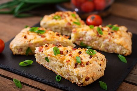 bread soda: Soda scones (bread)  with ham, cheese and chives. English cuisine.