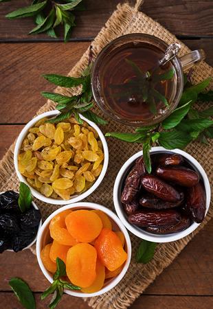 ramazan: Mix dried fruits (date palm fruits, prunes, dried apricots, raisins) and nuts, and traditional Arabic tea. Ramadan (Ramazan) food. Top view