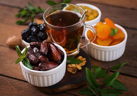 ramazan: Mix dried fruits (date palm fruits, prunes, dried apricots, raisins) and nuts, and traditional Arabic tea. Ramadan (Ramazan) food.