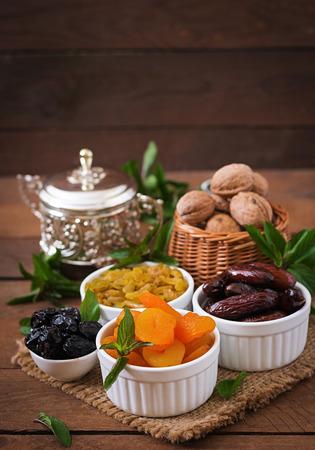 ramazan: Mix dried fruits (date palm fruits, prunes, dried apricots, raisins) and nuts. Ramadan (Ramazan) food. Stock Photo