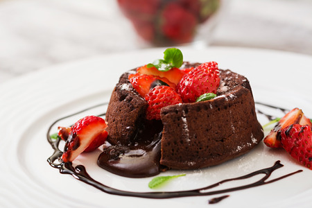 Chocolate fondant (cupcake) with strawberries and powdered sugar Stock fotó - 58180913