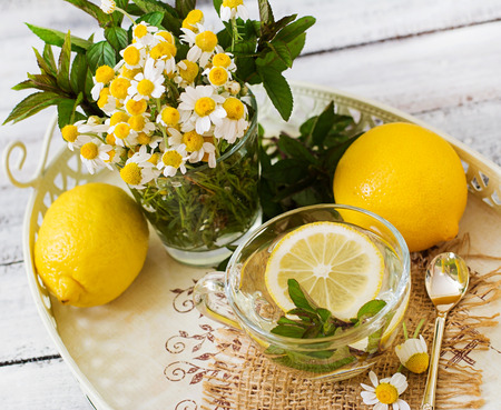 proper: Chamomile tea with lemon and mint. Herbal tea. Dietary menu. Proper nutrition.