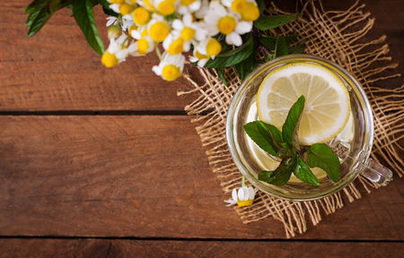proper: Chamomile tea with lemon and mint. Herbal tea. Dietary menu. Proper nutrition. Top view Stock Photo
