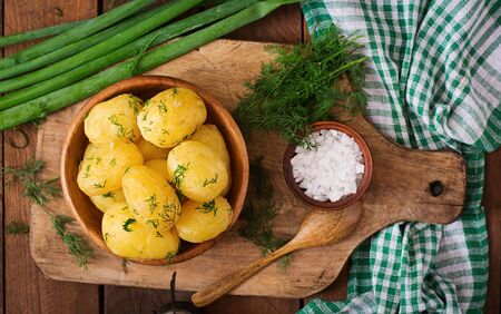 Boiled new potatoes seasoned with dill and butter. Top view