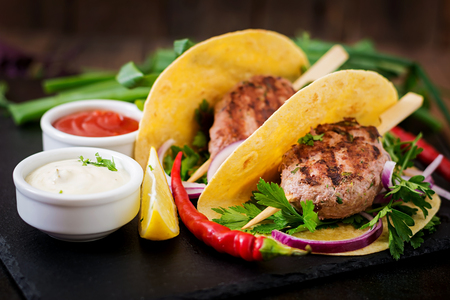 tortillas: Tortillas tacos with appetizing kebab (meatballs) and sauce on black background