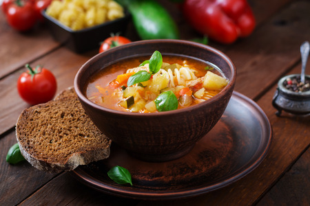 minestrone: Minestrone, italian vegetable soup with pasta on wooden table
