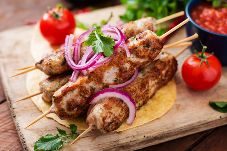 Minced Lula kebab grilled turkey (chicken) with vegetables. Stock Photo