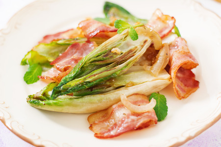 Baked chicory with bacon, onions and herbs.