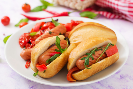 Hot dog with sausage and vegetables in the Greek style.