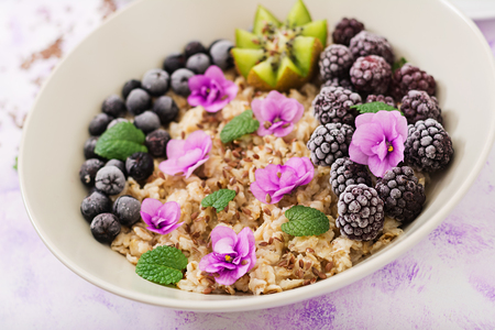 Tasty and healthy oatmeal porridge with fruit, berry and flax seeds. Healthy breakfast. Fitness food. Proper nutrition.