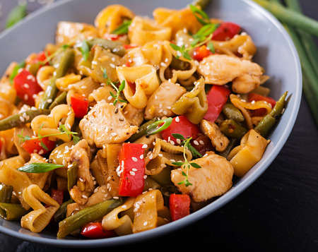 stirred: Stir Fry from chicken fillet, green beans and paprika with pasta in the form of heart