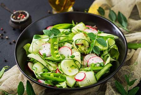 Fresh salad of cucumbers, radishes, green peas and herbs Stock Photo - 82112056