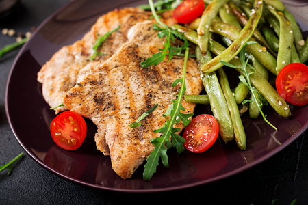 Turkey- chicken fillet cooked on a grill and garnish of green beans. Stock Photo - 82112065