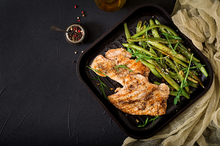 Turkey- chicken fillet cooked on a grill and garnish of green beans. Flat lay. Top view Stock Photo - 82112068