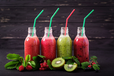 Fresh healthy smoothies from different berries on a dark background Stock Photo - 82112070