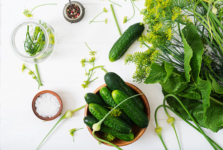 Preparation pickled marinated cucumbers, herbs and salt. Flat lay. Top view. Reklamní fotografie