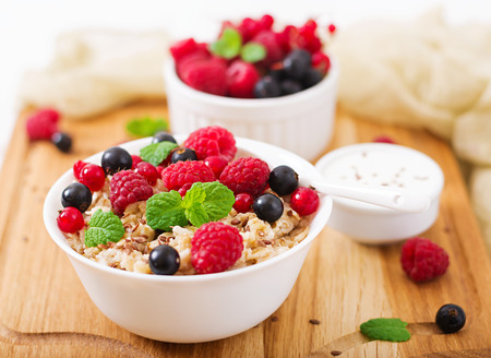 Tasty and healthy oatmeal porridge with berry, flax seeds and yogurt. Healthy breakfast. Fitness food. Proper nutrition