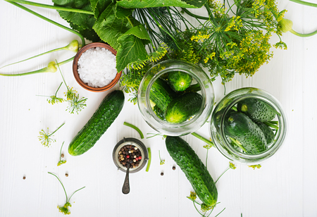 marinated gherkins: Preparation pickled marinated cucumbers, herbs and salt. Flat lay. Top view. Stock Photo