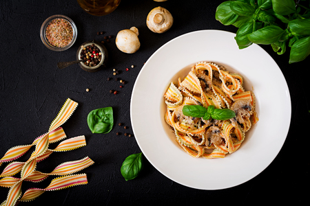 Colorful Pasta pappardelle with mushrooms in cream sauce. Flat lay. Top view. Stock Photo