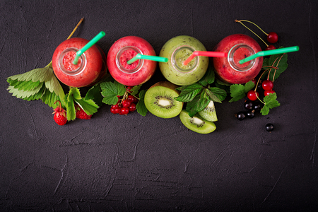 Fresh healthy smoothies from different berries on a dark background. Flat lay. Top view. Stock Photo - 82112199