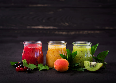 Fresh healthy smoothies from different berries on a dark background. Diet menu. Proper nutrition. Stock Photo